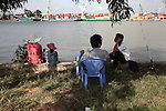 Fishermen wait for a bite on the Saigon River outside Ho Chi Minh City, Vietnam. Aug. 11, 2011.