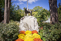 War Dog Memorial. Gravestones for owners' beloved pets in the Hartsdale Pet Cemetery in Hartsdale in Westchester County New York State on Sunday, September 22, 2013. The Hartsdale Pet Cemetery is the first pet cemetery in the United States, started in 1896 and incorporated as a cemetery in 1914. Recently the NYS Division of Cemeteries had ordered animal cemeteries in the state to stop the internment of pet owners' ashes with their pets but after the uproar the order was reversed as long as the cemetery was not charging the owners for the human internment. There are approximately 500 people already interned amongst the over 80,000 dogs, cats and other pets.  (© Richard B. Levine)