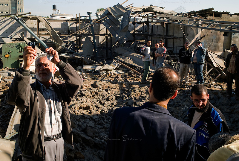 Zawaida, Gaza Strip, 22 Nov 2009.Almost a year after the 'Cast Lead' operation, an Israel Air Force F16 dropped 2 bombs on a metal workshop belonging to Md Namrutti, 65, under the suspicion that it might have been used for building rockets.