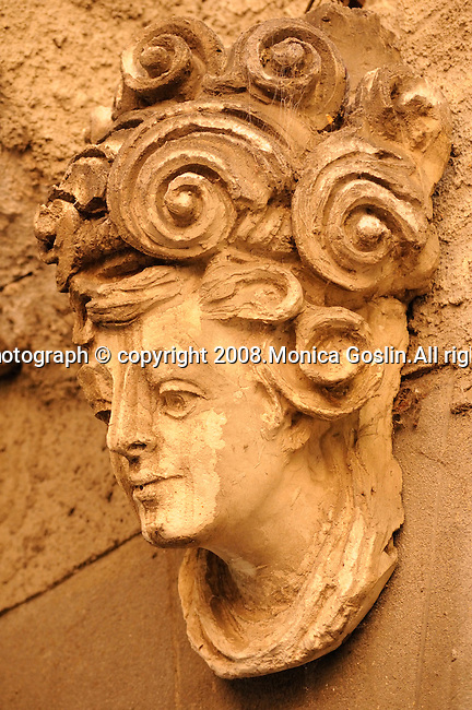 Detail of a decorative head above a door in Varenna, Italy on Lake Como.