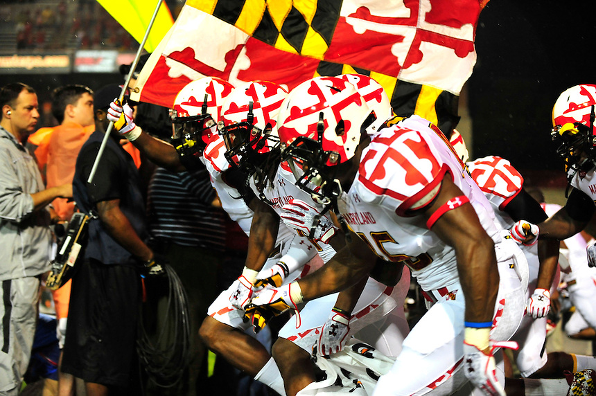 The Terrapins take to the field wearing their new uniform gainst the Miami Hurricane during a game at the Byrd Stadium in College Park, MD on Monday, September 5, 2011. Alan P. Santos/DC Sports Box
