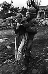 U.S. Army chaplain evacuates a Vietnamese woman, Têt offensive, Battle of Hué, Vietnam, February 1968