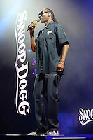 WEST PALM BEACH, FL - JULY 20: Snoop Dogg performs during opening night of The High Road Tour at The Perfect Vodka Amphitheater on July 20, 2016 in West Palm Beach Florida. Credit: mpi04/MediaPunch