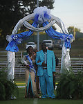 Moquinada Gooch is escorted by Sherman Gooch during Homecoming ceremonies before the Water Valley vs. J.Z. George football game in Water Valley, Miss. on Friday, September 10, 2010.