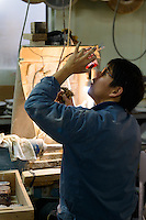 Checking a glass, Edokiriko workshop, Shimizu Glass, Tokyo, Japan, January 14, 2015. Edokiriko is a style of cut glass that dates back to 1834 and is similar to British cut glass. It makes use coloured glass and highly-intricate Japanese motifs.