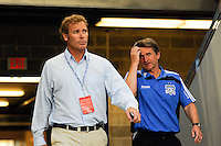 San Jose Earthquakes general manager John Doyle (L) and head coach Frank Yallop (R) enter the field. The New York Red Bulls defeated the San Jose Earthquakes 2-0 during a Major League Soccer (MLS) match at Red Bull Arena in Harrison, NJ, on August 28, 2010.