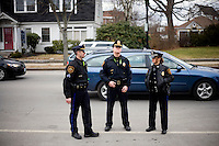 Police watch crowds and traffic outside a Mitt Romney town hall meeting and rally at the Rochester Opera House in Rochester, New Hampshire, on Jan. 8, 2012. Romney is seeking the 2012 Republican presidential nomination.
