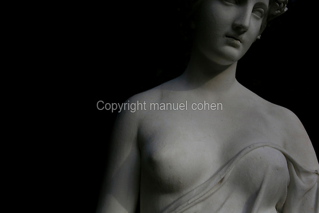 Statue called Nymphe a la Cruche, created by Hippolyte-Isidore Brion in 1838 and located in the Iris Garden of the Jardin des Plantes, Paris, 5th arrondissement, France. Founded in 1626 by Guy de La Brosse, Louis XIII's physician, the Jardin des Plantes, originally known as the Jardin du Roi, opened to the public in 1640. It became the Museum National d'Histoire Naturelle in 1793 during the French Revolution. Picture by Manuel Cohen