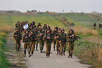 Israeli infantry soldiers on the march, moments after withdrawing from the Gaza strip. Israeli forces began an air offensive against Hamas in Gaza on 27/12/2008, which quickly escalated into an offensive by land, sea and air, in retaliation against Palestinian rockets fired into Israel. They ended their campaign after 22 days of fighting.
