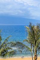 A couple enjoy Ka'anapali Beach, West Maui.