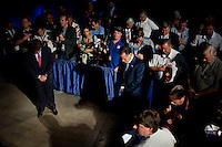 Candidate for president Mitt Romney, center, bows his head in observance of the flag during closing ceremonies at the Veterans of Foreign Wars national convention, Tuesday, Aug. 30, 2011, in San Antonio. (Darren Abate/pressphotointl.com)