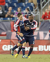New England Revolution midfielder Kelyn Rowe (11) celebrates his goal with New England Revolution defender Andrew Farrell (2). In a Major League Soccer (MLS) match, Montreal Impact (white/blue) defeated the New England Revolution (dark blue), 4-2, at Gillette Stadium on September 8, 2013.