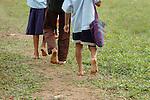 Barefoot Mayan children walk to school in southern Belize.