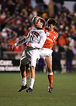 New Mexico's Cody Hanna (21) and Clemson's Bradley Gibson (2) challenge for a header. The University of New Mexico Lobos defeated the Clemson University Tigers 2-1 in a Men's College Cup Semifinal at SAS Stadium in Cary, NC, Friday, December 9, 2005.