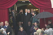 United States President-elect George W. Bush arrives at the ceremony at the U.S. Capitol where he will be sworn-in as the 43rd President of the United States on January 20, 2001.  Standing behind him are Speaker of the U.S. House Dennis Hastert (Republican of Illinois) and U.S. House Majority Leader Dick Armey (Republican of Texas).     .Credit: David N. Berkowitz for Newsweek - Pool via CNP.