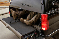 Counter assault Secret Service agents feet coming out the back of a motorcade vehicle upon arrival at Saudi Arabia's King Abdullah's ranch , where US President George W. Bush was visiting in Janadriyah, Saudi Arabia..Photo by Brooks Kraft/Corbis.