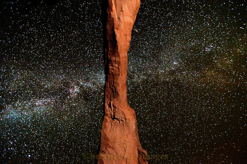 Unique view of a long fragile arch in Arches National Park, Utah backed by our Milky Way galaxy.