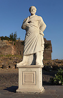 Modern statue of Aristotle, 384-322 BC, Greek philosopher, at the town entrance of Assos, Turkey. The city was founded from 1000 to 900BC by Aeolian colonists from Lesbos. Aristotle (joined by Xenocrates) went to Assos, where he was welcomed by King Hermias, and opened an Academy in this city, where he led an influential group of philosophers. The statue is broken and the right hand is missing. Picture by Manuel Cohen