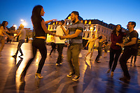 Romania. Iași County. Iasi. Town center. Couple dance salsa at twilight on Union Square. In the back, the Grand Hotel Traian was designed and built by Gustave Eiffel. Iași (also referred to as Iasi, Jassy or Iassy) is the largest city in eastern Romania and the seat of Iași County. Located in the Moldavia region, Iași has traditionally been one of the leading centres of Romanian social life. The city was the capital of the Principality of Moldavia from 1564 to 1859, then of the United Principalities from 1859 to 1862, and the capital of Romania from 1916 to 1918. 7.06.15 © 2015 Didier Ruef
