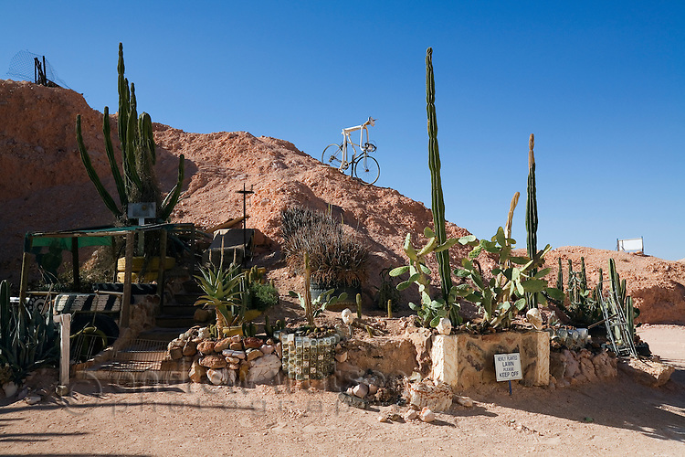 The quirky desert garden of Crocodile Harry 's house - a Latvian born opal miner and Coober Pedy eccentric who passed away in 2006.  Coober Pedy, South Australia, AUSTRALIA.