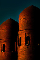 View from the side of the towers of the Ata-Davarza, main gate of Ichan-Kala, Khiva, Uzbekistan, seen at twilight, on July 6 2010. It was built in 1842, demolished in 1920 and rebuilt in 1975.