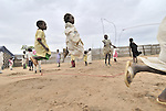 Children play outside their school in a camp near Bilel, where families displaced by the conflict in the Darfur region of Sudan have taken refuge from the violence.