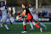 Jacques Burger of Saracens looks to pass the ball. Aviva Premiership match, between Saracens and Bath Rugby on January 30, 2016 at Allianz Park in London, England. Photo by: Patrick Khachfe / Onside Images