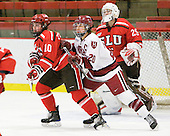 Brooke Fernandez (St. Lawrence - 10), Kate Buesser (Harvard - 20) - The Harvard University Crimson defeated the St. Lawrence University Saints 8-3 (EN) to win their ECAC Quarterfinals on Saturday, February 26, 2011, at Bright Hockey Center in Cambridge, Massachusetts.