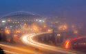 WA11195-00...WASHINGTON - Interstate 90 and Century Link Field on a foggy morning viewed from the 12 Avenue bridge.