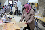A Palestinian woman works at at a carpentry in Beit Lahia in the northern Gaza strip on Feb. 14, 2017. More than 8 woman works at carpentry to help their husbands as the Israeli blockade of the Gaza Strip continues. They produced more than 1,700 wooden toys and they sold it 3-8$ per one. Photo by Mohammad Sallam