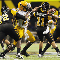 West's Owa Odighizuwa, center, tackles East quarterback Barry Brunetti, right, as he is blocked by East's Shon Coleman during the U.S. Army All-American Bowl, Saturday, Jan. 9, 2010, at the Alamodome in San Antonio. (Darren Abate/pressphotointl.com)