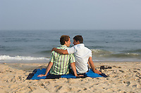 two men enjoying time together on the beach in East Hampton, NY