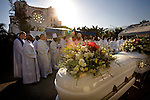 The funeral for Archbishop Joseph Serge Miot and Vicar General Charles Benoit, who died in the Jan. 12 earthquake, outside the ruins of the National Cathedral in Port-au-Prince, Haiti, Saturday Jan. 23, 2010.