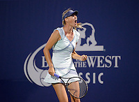 Maria Sharapova celebrates after winning a point as she defeates Zheng Jie 6-4, 7-5, in the opening round of the Bank of the West Classic, in Stanford, California, July 27, 2010.