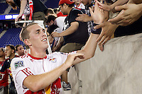 Corey Hertzog (6) of the New York Red Bulls celebrates with fans after the match. The New York Red Bulls defeated FC New York 2-1 during a third round match of the 2011 Lamar Hunt US Open Cup at Red Bull Arena in Harrison, NJ, on June 28, 2011.