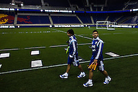 Argentina striker Sergio Aguero (R ) and Ever Banega arrive to a practice at Red Bull stadium ahead of his friendly match against Ecuador in New Jersey, Nov 13, 2013. VIEWpress/Eduardo Munoz Alvarez