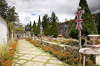 The Kundasang War Memorial is located near the renowned vegetable market in Kundasang Village. It was established as a tribute to World War II prisoners of war who died during the Sandakan Death Marches in 1945.The Kundasang War Memorial is located near the renowned vegetable market in Kundasang Village. It was established as a tribute to World War II prisoners of war who died during the Sandakan Death Marches in 1945. The fort-like Memorial was designed by J.C. Robinson, a local architect. It has four interlocking but separate gardens to represent the homelands of those who died: an Australian Garden, a formal English Garden of roses, a Borneo Garden with wild flowers of Kinabalu and at the top level is the 'Contemplation Garden' with a reflection pool and pergola.