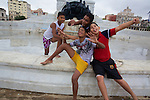 Local Boys Having Fun In Front Of General Máximo Gómez Statue