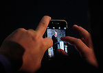 Ottawa, ON – Nov 27 2015 –Donald Royer is seen on a mobile phone screen as he speaks at the Canadian Paralympic Hall of Fame in Ottawa, Ontario Nov 27, 2015. Royer was inducted into the Hall of Fame in the builder category. Photo Andre Forget / Canadian Paralympic Committee