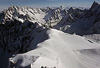 Skiers at the top of Aguille du Midi (12,602 feet or 3842 meters)must rope together to get to get to the starting point for a panaramic top view of the top of Mont Blanc.  Mountains guides assist the difficult terrain for the long ski down the mountain. Mont Blanc is the highest mountain in the Alps--4807 meters.