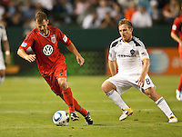 CARSON, CA – June 3, 2011: DC United defender Daniel Woolard (21) moves the ball past LA Galaxy midfielder Chris Birchall (8) during the match between LA Galaxy and DC United at the Home Depot Center in Carson, California. Final score LA Galaxy 0, DC United 0.