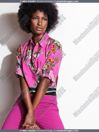 Beautiful young african american black woman wearing pink floral shirt and pants. Fashion photo isolated on white background.