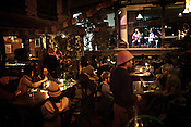 Tourists and Local Nepalese are seen enjoying a concert at a local bar in Thamel in capital Kathmandu, Nepal