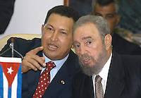 "Cuban President Fidel Castro (R) and his Venezuelan counterpart Hugo Chavez meet with Cuban politicians and Venezuelans in a protocol living room of ""El Laguito"", Saturday, August 20, 2005 in Havana, Cuba. Credit: Jorge Rey/MediaPunch"