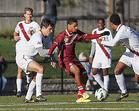 Boston College forward/midfielder Zeiko Lewis (19) passes the ball despite tight defense by Virginia Tech defender Alessandro Mion (4).Boston College (maroon) defeated Virginia Tech (Virginia Polytechnic Institute and State University) (white), 3-1, at Newton Campus Field, on November 3, 2013.
