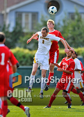 12 October 2011: University of Vermont Catamount Defender Joe Losier, a Senior from Glastonbury, CT, jumps against Sanford Spivey in action against the Boston University Terriers at Centennial Field in Burlington, Vermont. The Catamounts were edged out 1-0 by the visiting Terriers. Mandatory Credit: Ed Wolfstein Photo