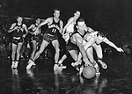 The first time North Carolina coach Dean Smith appeared in the NCAA Final Four, it was as player and member of the 1952 Kansas University team that won the National Championship that year. Here, Smith chases a loose ball in the semi-final game with Santa Clara won by Kansas 74-55. Rich Clarkson