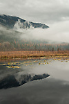 The clouds and mountain reflecting onto Perkins Lake in the fall