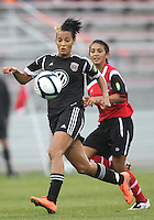 BOYDS, MARYLAND - July 21, 2012:  Lianne Sanderson (10) of DC United Women moves the ball away from Taylor Mertz (5) of the Virginia Beach Piranhas during a W League Eastern Conference Championship semi final match at Maryland Soccerplex, in Boyds, Maryland on July 21. DC United Women won 3-0.