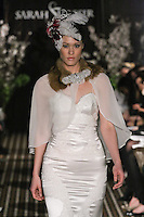 Model walks runway in a Breathless wedding dress by Sarah Jassir, for the Sarah Jassir Fall 2011 - Desire bridal collection.